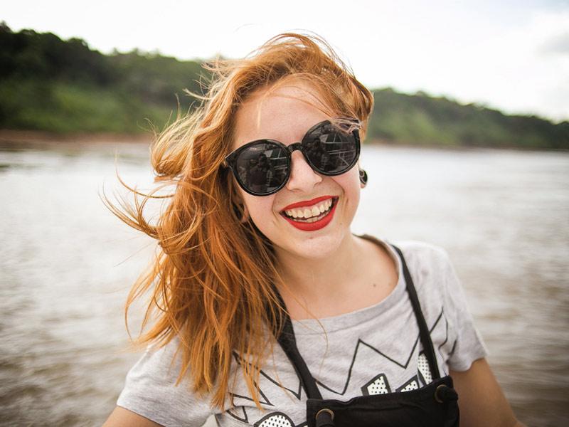Girl wearing oversize sunglasses